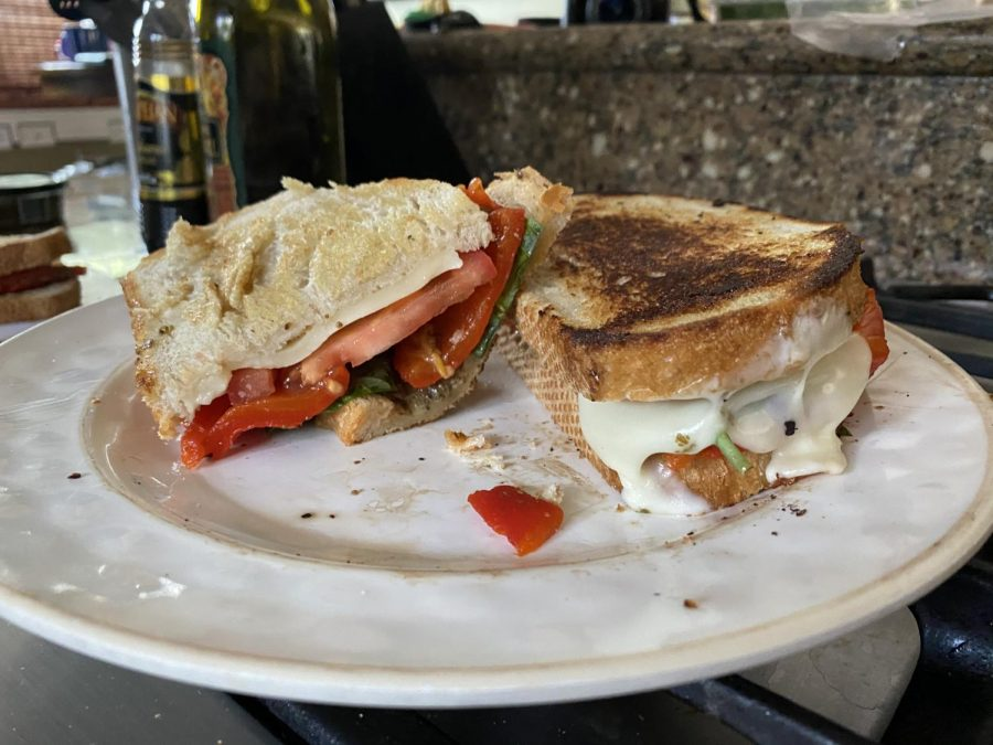 Melted+mozzarella%2C+tomato%2C+spinach+and+pesto+pair+perfectly+on+this+simple+sandwich.+