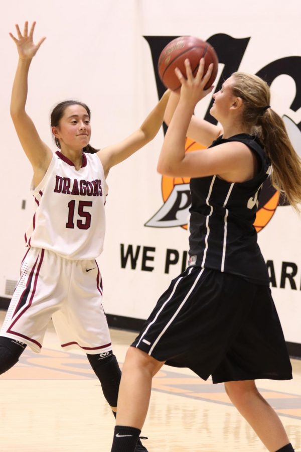 Maddie Ozbourn 19 searches for an open player to pass to