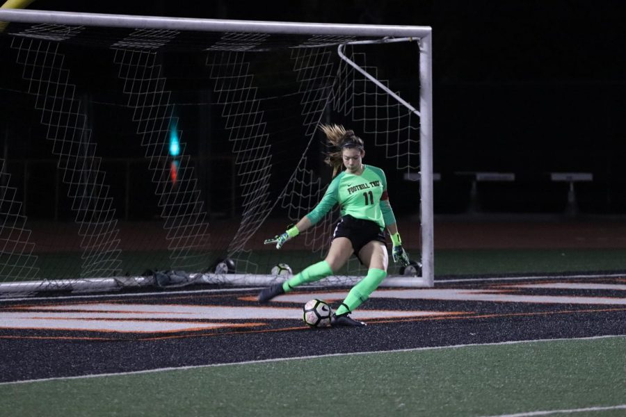 Keara Fitzgerald 20 passes the ball back to her teammates.