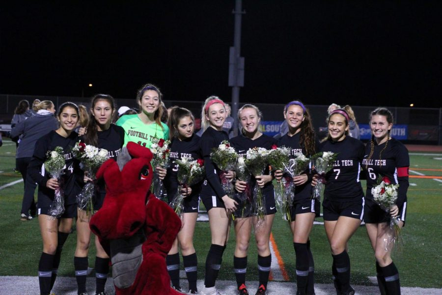 The senior girls pose on senior night, their last home game before CIF.