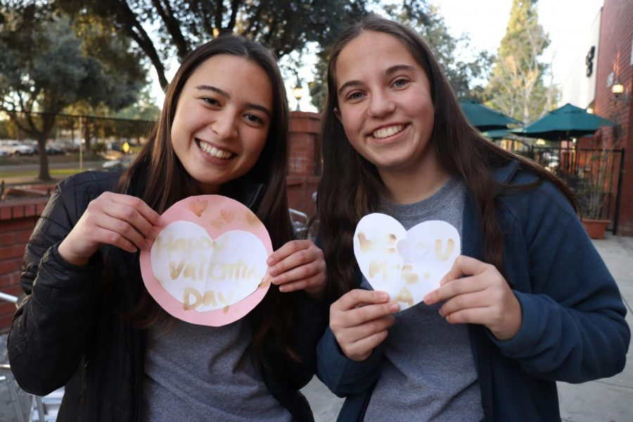 Marie Bell 21 and Maya Thompson 21 showing off the results of their art projects.