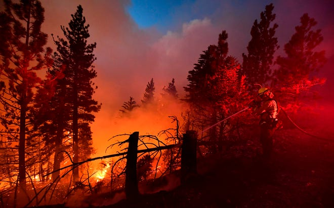 Firefighters battling California wildfires in September 2020.