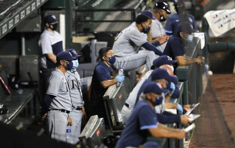 Tampa Bay Rays wearing masks while waiting for the action to unfold.