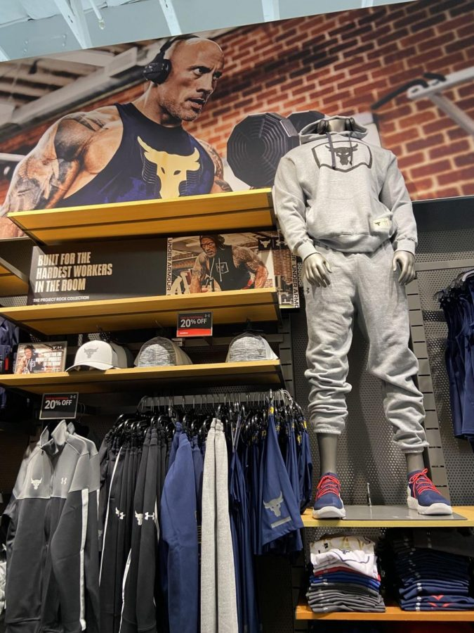 Men's clothing at Under Armour sponsored by famous athletes such as Dwayne Johnson and Stephen Curry.