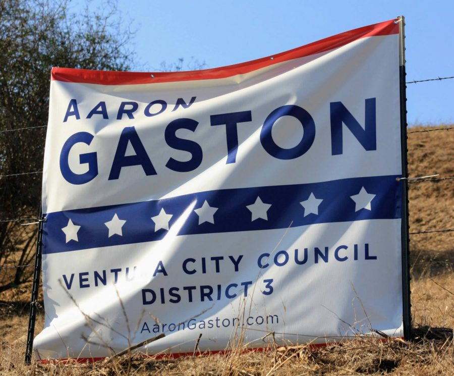 Candidate Aaron Gaston self advertising, using banners to catch locals eyes.