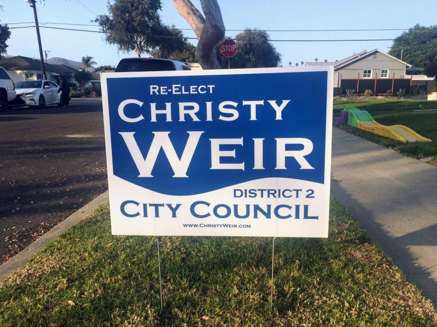 Incumbent City Council member Christy Weir's re-election campaign is advertised in District two.