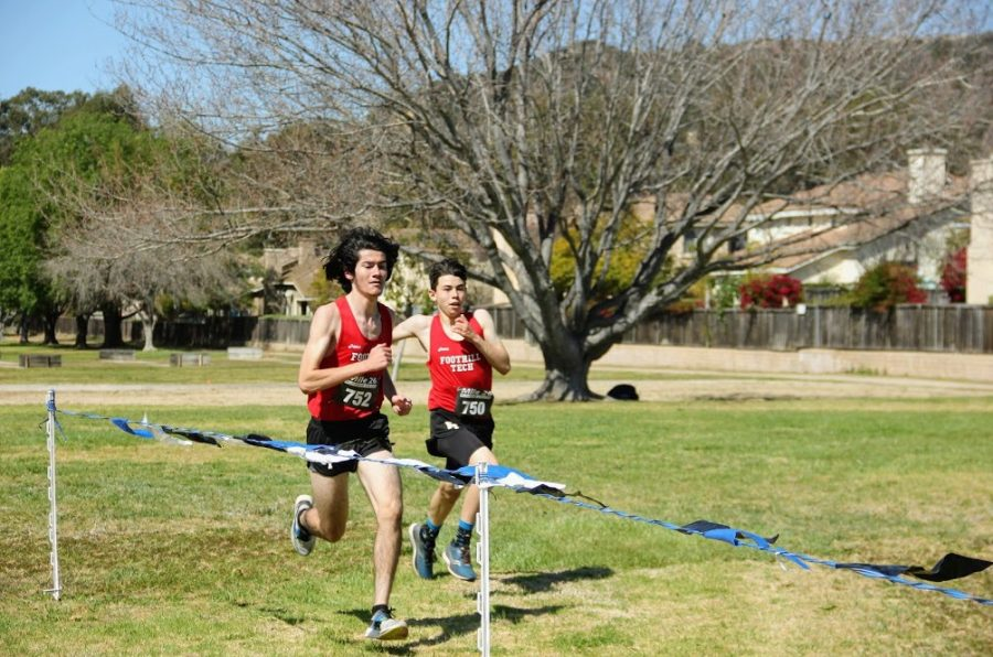 Christian Flores 22 and Owen Evans 24 race to the finish line.