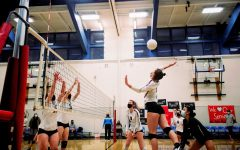 Aubrey Mullin '22 leaps into the air to strike the ball.