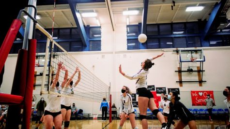 Aubrey Mullin 22 leaps into the air to strike the ball.