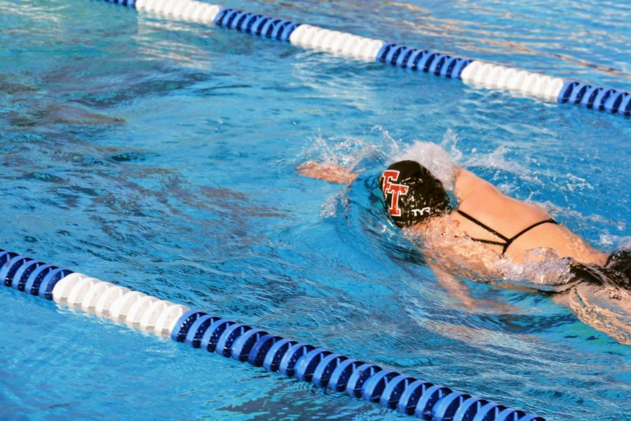 The Foothill girls swim team speeds through the water during their first race in over a year.