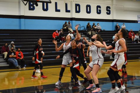 Rome Falcocchia '22, Chloe Scofield '22 and Olivia Huynh '23 box out Rio Mesa defenders as they look for a chance to rebound the ball.