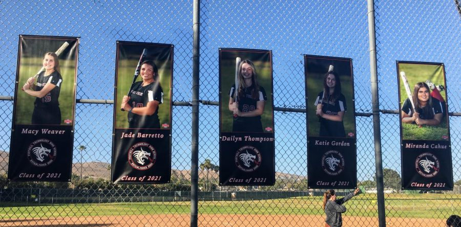 Softball team hangs banners for seniors Macy Weaver '21, Jade Barretto '21, Dailyn Thompson '21, Katie Gordon '21 and Miranda Cahue '21 on Senior Night.
