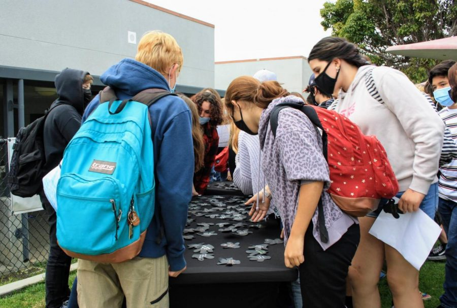 Freshmen search for their names on the Mickey Mouse hands.