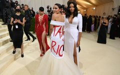 """Representative Alexandria """"AOC"""" Ocasio-Cortez walks down red carpet in news-provoking dress with red statement """"Tax The Rich"""". Source: Getty Image"""