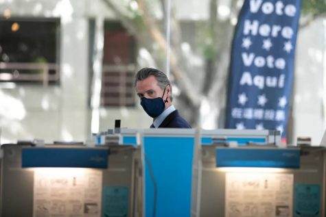 Gov. Gavin Newsom votes at the polls in his own recall election.