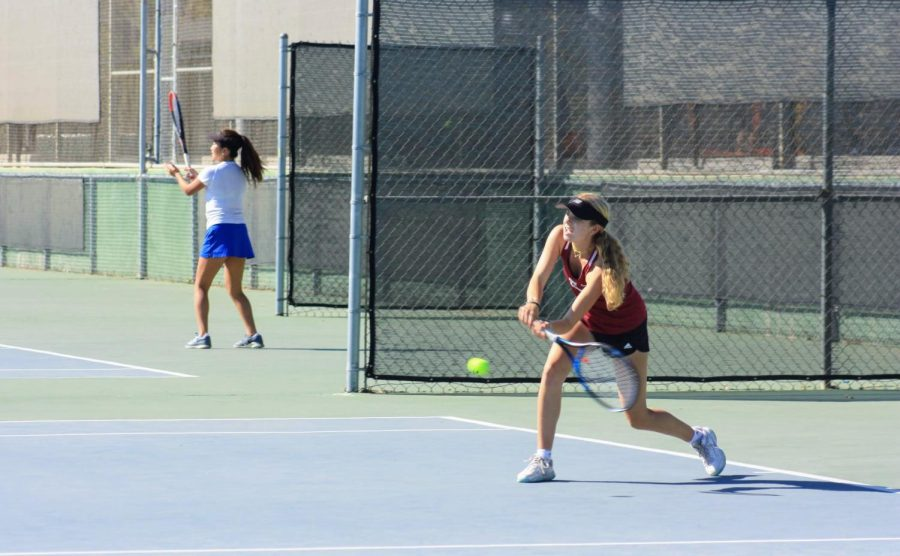 Anna English 24 reaches to hit the ball to her opponent.