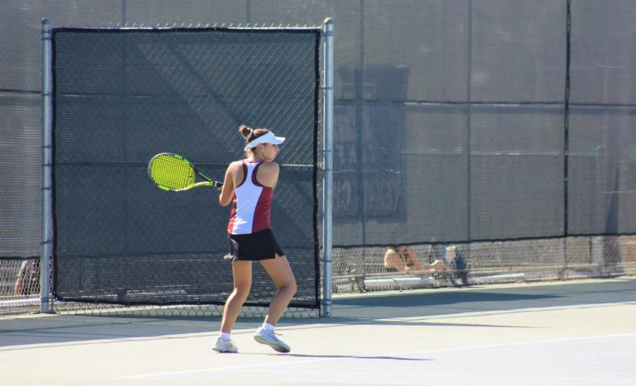 Kira Branson 24 keeps her eye on the ball preparing to send it to her opponent.