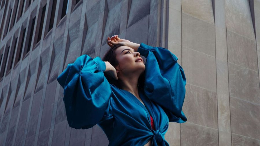 Mitsuki Laycock (Mitski) poses in blue in for her new songs promotional photoshoot.