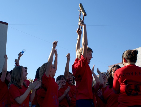 """Junior Aron Egelko holds """"The Golden Crutch"""" in victory after Cohort 6 won the BioScience Olympics. Maya Morales/The Foothill Dragon Press."""