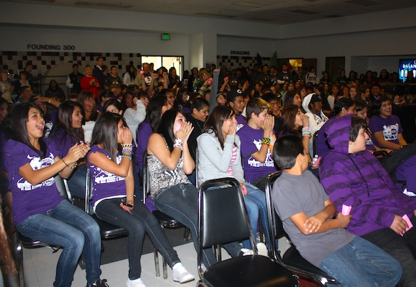 AVID middle school students laugh during an introductory presentation in Spirito Hall. Credit: Eva Morales/The Foothill Dragon Press.