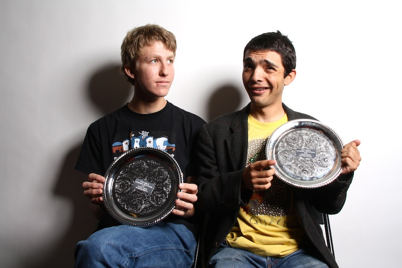 Seniors Aron Egelko and Kevin Kunes show off the quarterfinal plates that they earned last weekend at UC Berkeleys high school debate tournament. Credit: Aysen Tan/The Foothill Dragon Press.