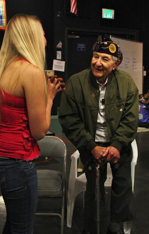 Holocaust survivor Bernd Simon talks with sophomore Anna Cogswell. Credit: Aysen Tan/The Foothill Dragon Press