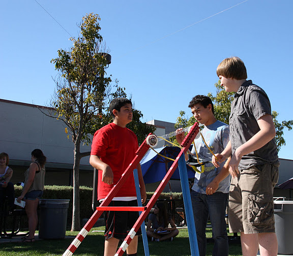 Sophomores Saad Fakhouri, Christian Alamillo, and Tanner Woodward launch their catapult for conceptual physics. Credit: Emilie Ghafouri/The Foothill Dragon Press.