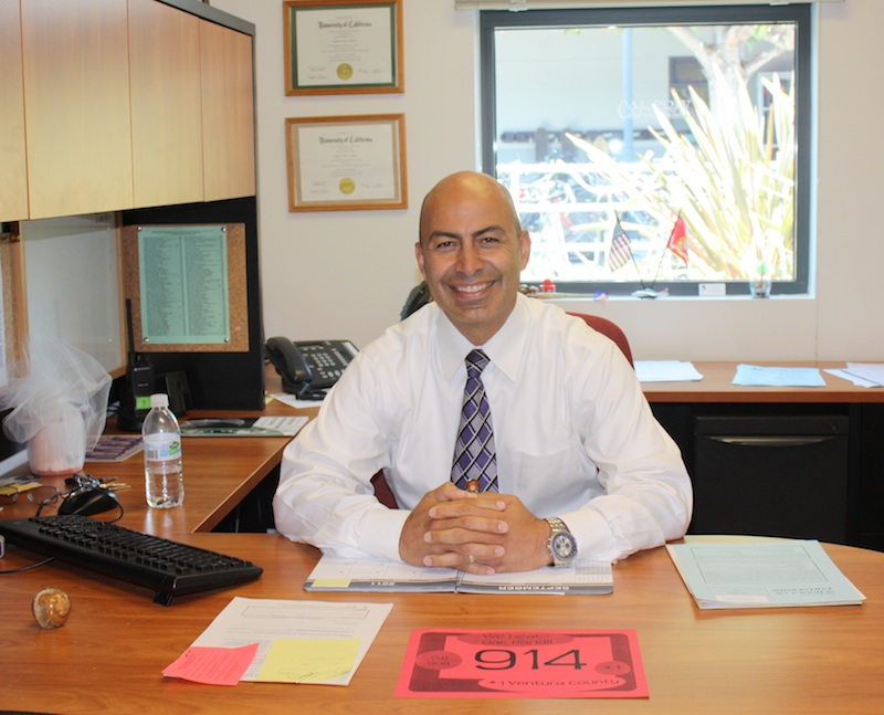 Carlos Cohen, one of Foothills new assistant principals, poses in his office. Credit: Jackson Tovar/The Foothill Dragon Press.