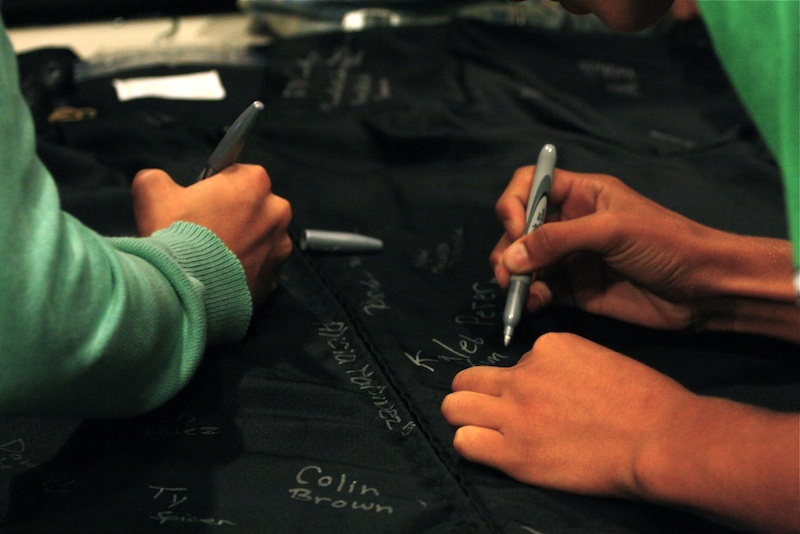 Freshmen signed a graduation gown to symbolize their commitment to graduate in four years. Credit: Aysen Tan/The Foothill Dragon Press.
