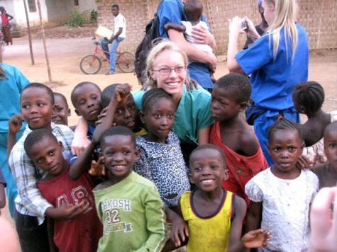 Emma Huebner hangs out with the local children in Lungi, Sierra Leone. Credit: John Huebner.