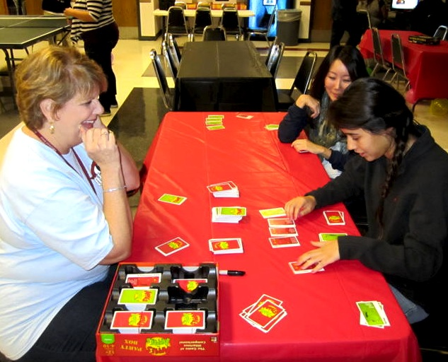 Counselor Debbie Freeman laughs while playing Apples to Apples with students at Foothills first Friday Night Live. Credit: Eva Morales/The Foothill Dragon Press