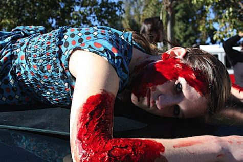 """Senior Gabby Trainor acts as a dead victim of a drunk driving accident during the simulation """"Every 15 Minutes"""" yesterday. Credit: Rachel Crane/The Foothill Dragon Press."""