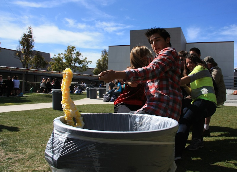 Senior Alex Villalpando participates in the tug-of-war competition on Tuesday. Credit: Aysen Tan/The Foothill Dragon Press