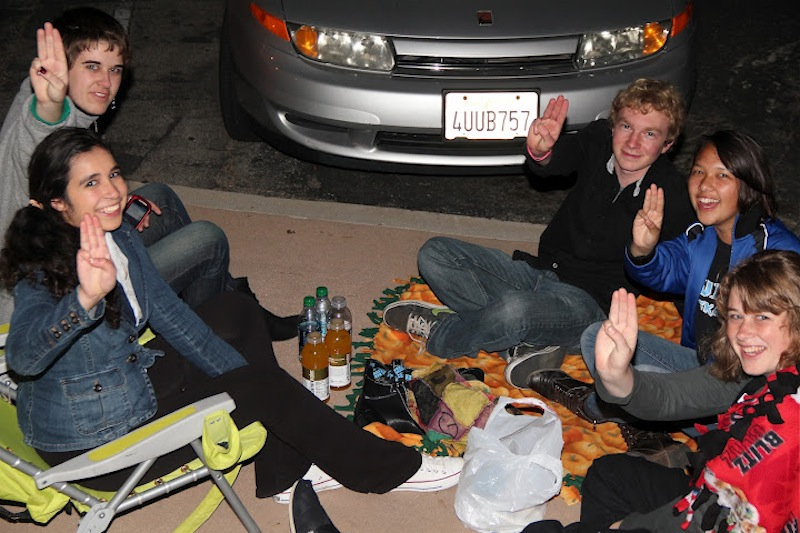 """Foothill students Hannah Rivera, Elena Schink, Kieran Giammichele, Sarah Serrano, and Karina Schink wait outside Century 16 Thursday night for the midnight premiere of """"The Hunger Games."""" Credit: Glenda Marshall/The Foothill Dragon Press"""