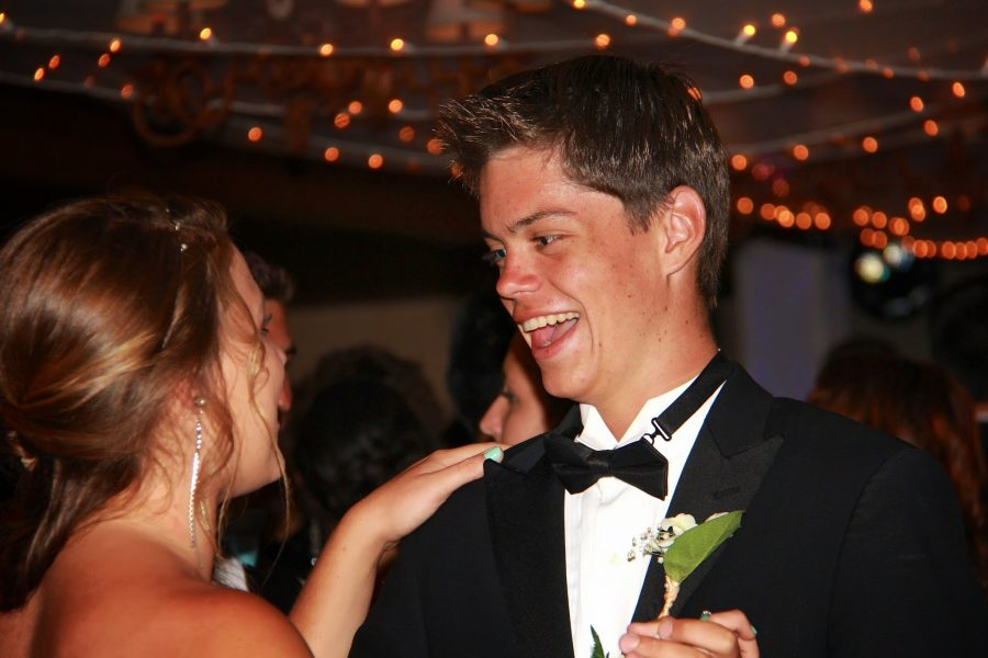 """Junior Emily Graves and sophomore James Florez dance together at this year's """"magic"""" prom. Credit: Josh Ren/The Foothill Dragon Press"""