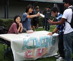 KIWIN's president Sharon Choi hands out flyers to promote the new club during Club Rush. Karie Portillo/The Foothill Dragon Press.