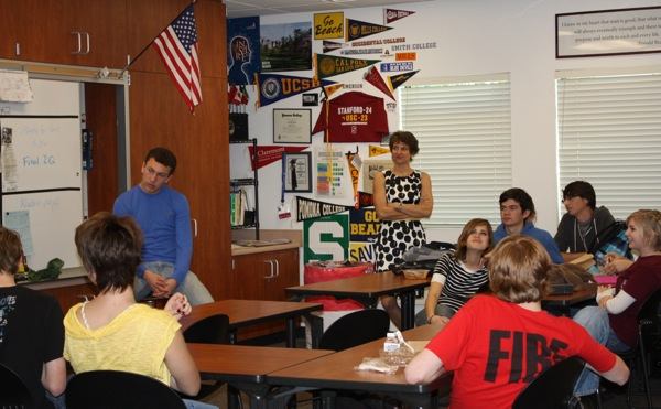 """PACC Advisor Cherie Eulau looks on as members discuss the """"patriotic pause"""" last Friday. Photo Credit: Karie Portillo/The Foothill Dragon Press."""