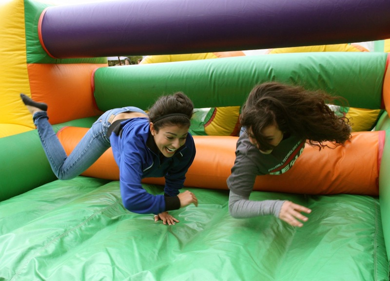 Sophomores Jesa Bryant-Simental (left) and Holly Guzman (right) have fun on an inflatable maze during Fridays Renaissance Rally. Credit: Felicia Perez/The Foothill Dragon Press