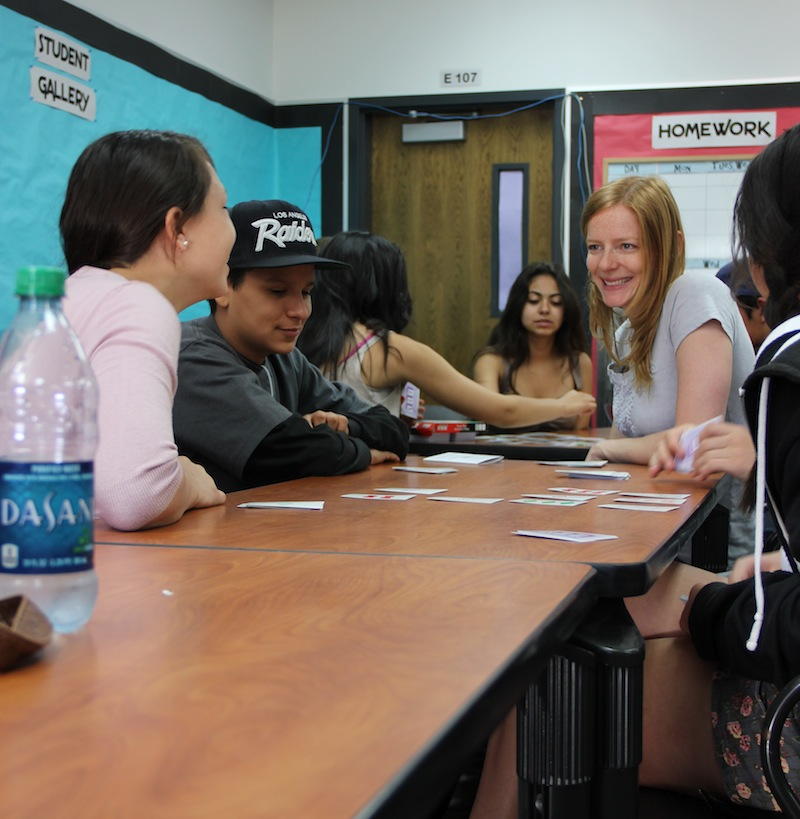 Freshmen Cristina Orozco and Isaac Tadeo work with Foothill math teacher Alice Rocca on a math patterns game. Credit: Felicia Perez/The Foothill Dragon Press