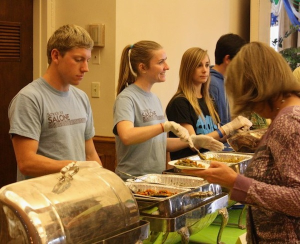 Members of Foothill for Africa serve traditional Sierra Leonean food at the club's last fundraiser yesterday. Credit: Rachel Crane/The Foothill Dragon Press.