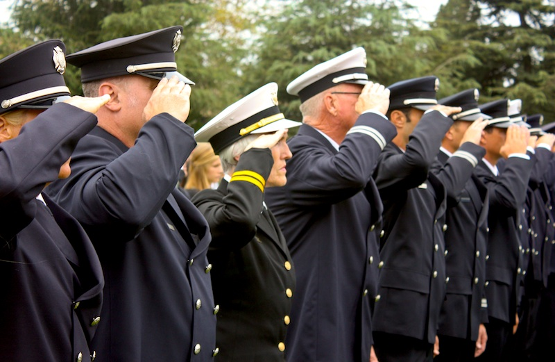 Police officers salute in remembrance of those who lost their lives on September 11, 2001. Credit: Rachel Crane/The Foothill Dragon Press.