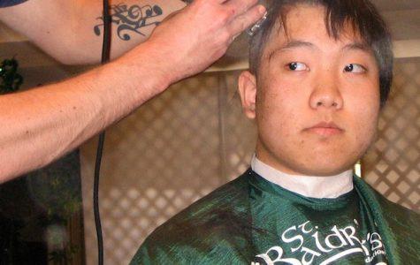 Senior Trenton Pham reflects on the experience of shaving his head for St. Baldrick's. Credit: Tracie Pham.