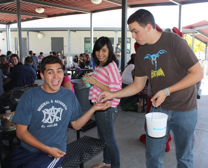 ASB member senior David White hands out candy to junior Daniel Garcia to help motivate students to do well on their testing this year. Credit: Eva Morales/The Foothill Dragon Press.