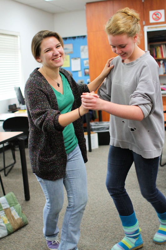 Junior Angela King and senior Bryn Gallagher dance together in the Swing Dance Club. Credit: Aysen Tan/The Foothill Dragon Press
