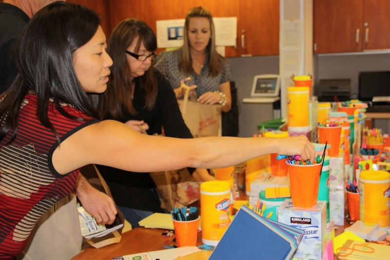 "Science teacher Mika Anderson reaches for supplies at the annual ""Teacher Tower."" Credit: Bridget Parrino/The Foothill Dragon Press"