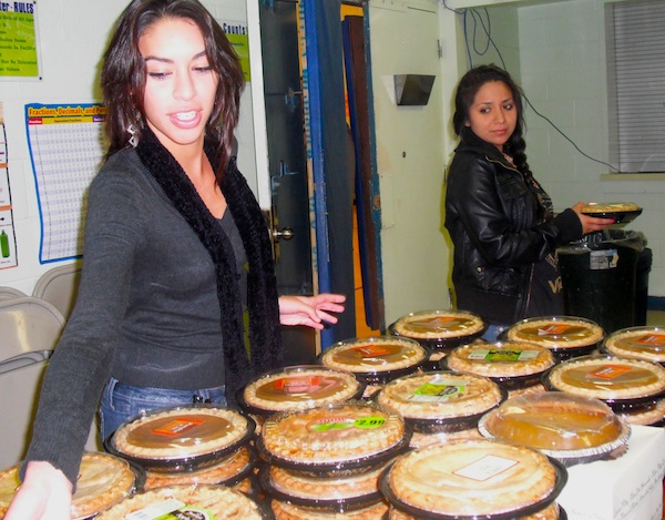 Juniors Celeste Lopez and Sandra Teran organize pies before handing them out in Thanksgiving Baskets to needy families. Credit: Eva Morales/The Foothill Dragon Press.