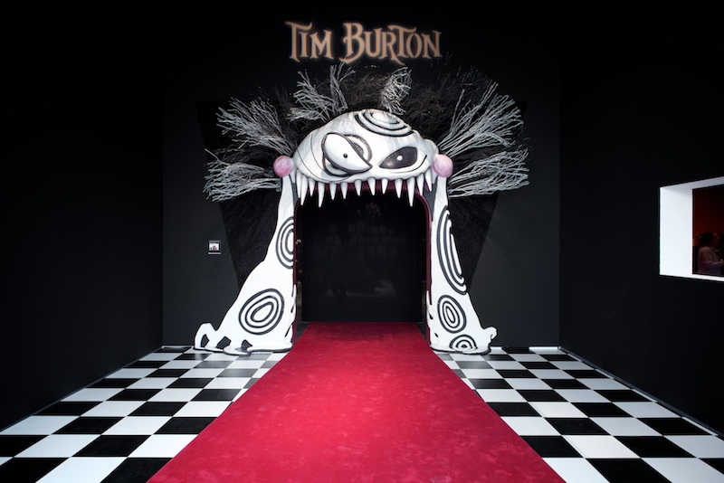 The open mouth of one of his characters serves as the entrance to Tim Burtons exhibit at the Los Angeles County Museum of Art. Creative Commons Photo by Flickr user brandon shigeta.