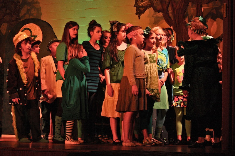 """Young artists perform as the citizens of the Emerald City in PTYA's production of """"Wizard of Oz."""" Credit: Caitlin Trude/The Foothill Dragon Press."""