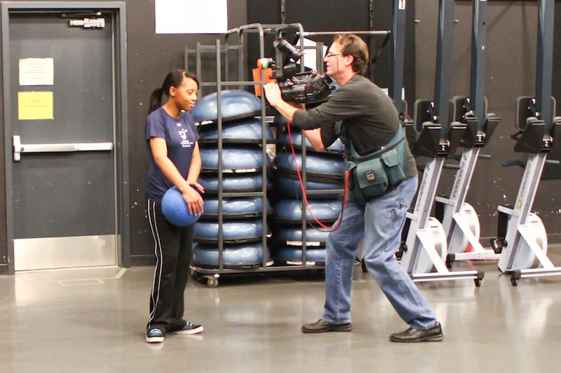 A Nickelodeon film crew takes footage of Richardson for a segment about visually impaired children. Credit: Aysen Tan/The Foothill Dragon Press