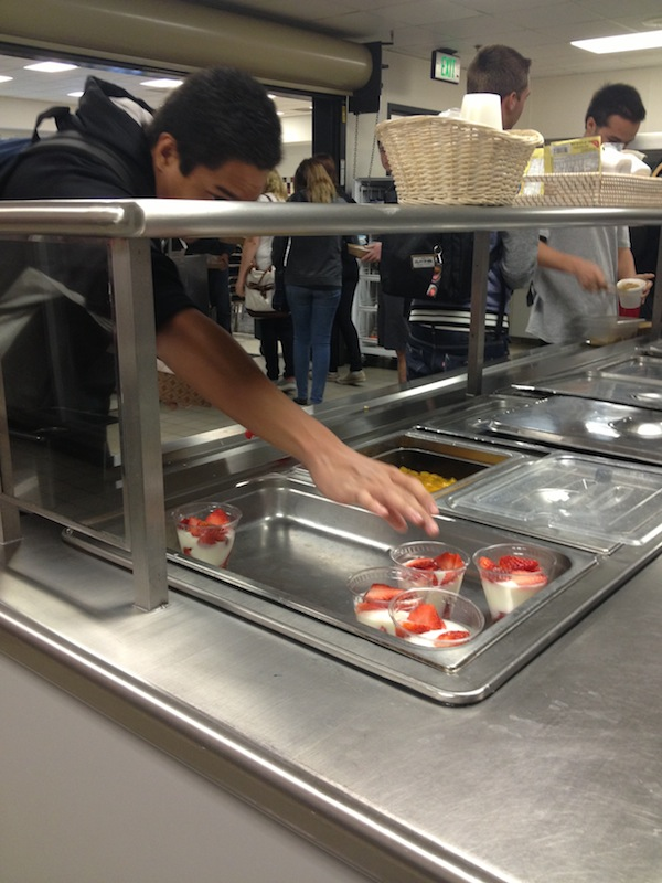 Senior Anthony Balolong-Reyes reaches for a yogurt cup in the cafeteria. Credit: Felicia Perez/The Foothill Dragon Press